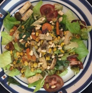 Romaine lettuce, sprouted tofu, carrots, shiitake mushrooms, roasted orn, broccoli, collard greens, kale, garlic, sesame seed oil, namashoya, tomatoes, pine nuts.