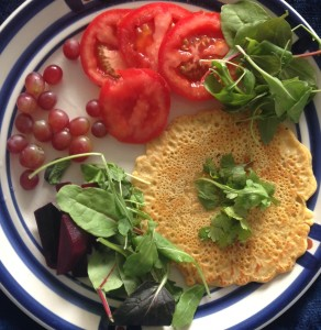 Grapes, tomatoes, spicey greens, garbanzo bean pancake with herbs de provence, himalaya salt, fresh ground black pepper, topped with cilantro, beets.